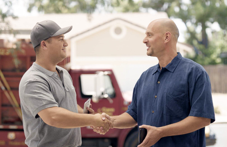 Two contractors shakign hands