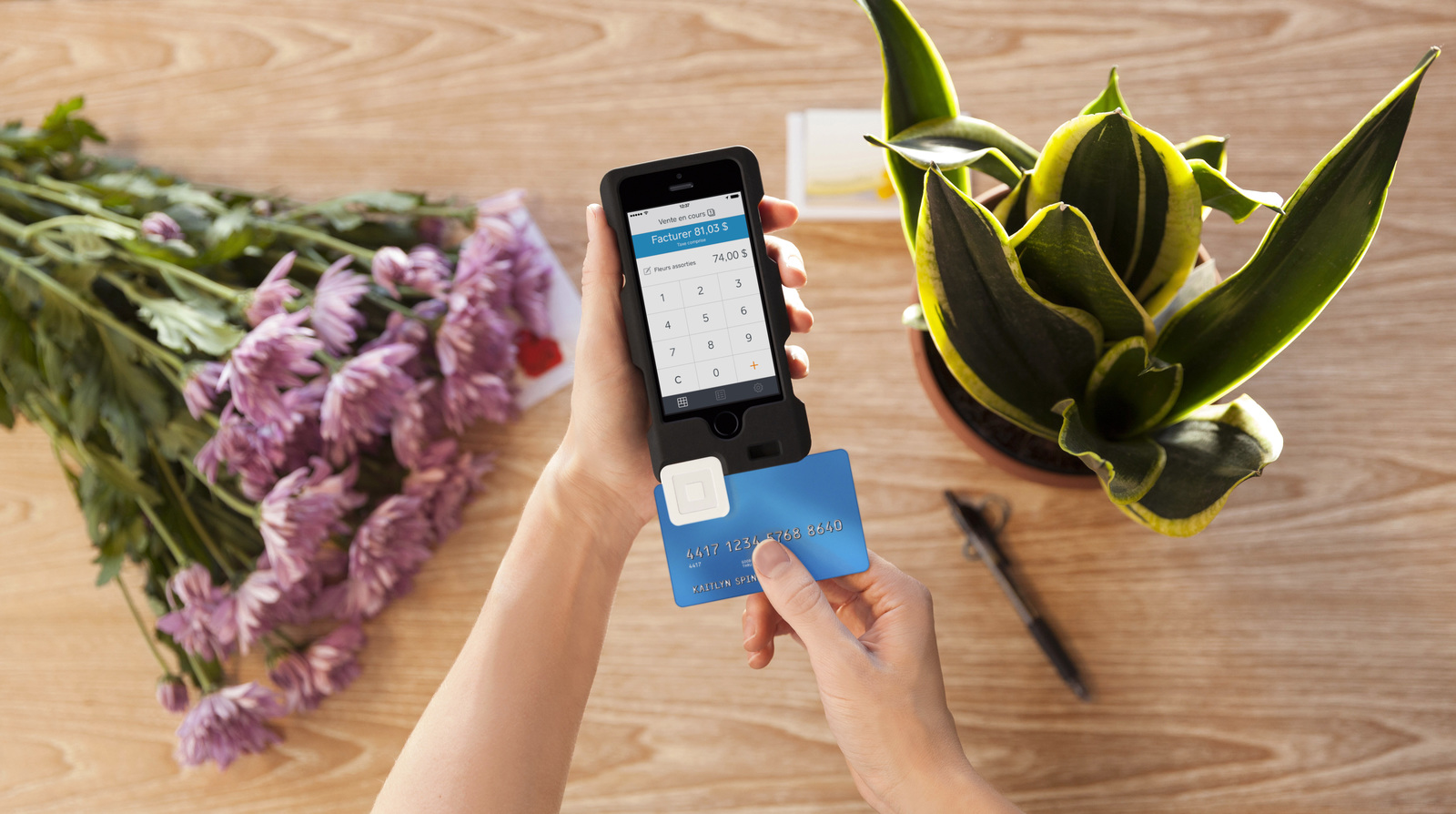 swiping a credit card on a mobile device